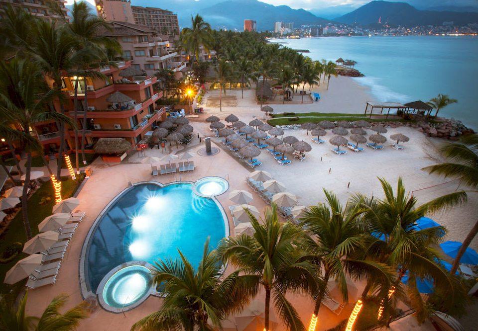 Beachfront Buildings Exterior Hot tub/Jacuzzi Lounge Pool tree leisure Resort Water park caribbean amusement park Beach plant