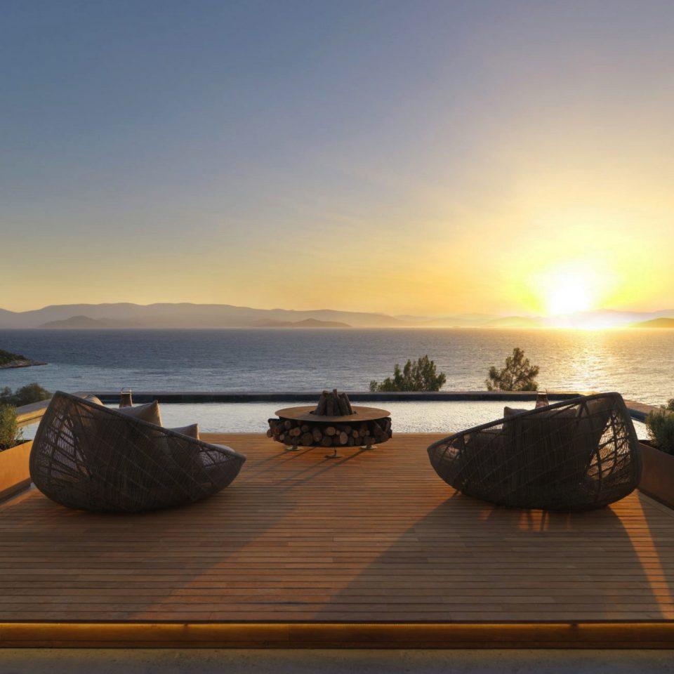 Beachfront Deck Lounge Luxury Modern Pool sky Sea Ocean Sunset shore morning Coast evening Beach vehicle dusk sunrise