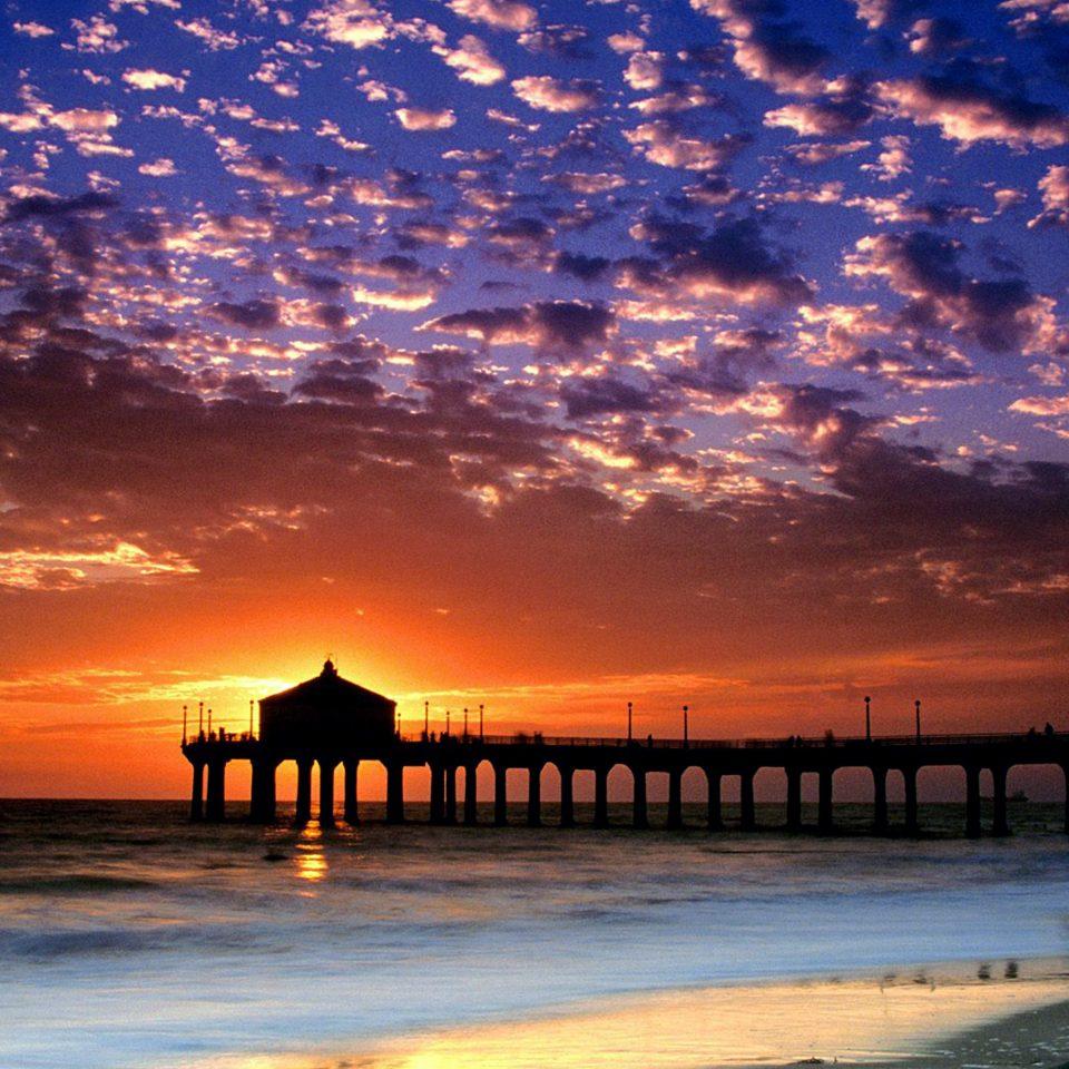 Beach Beachfront Deck Ocean Sunset water sky scene pier horizon afterglow Sea sunrise Sun dawn dusk cloud evening morning Coast setting sunlight