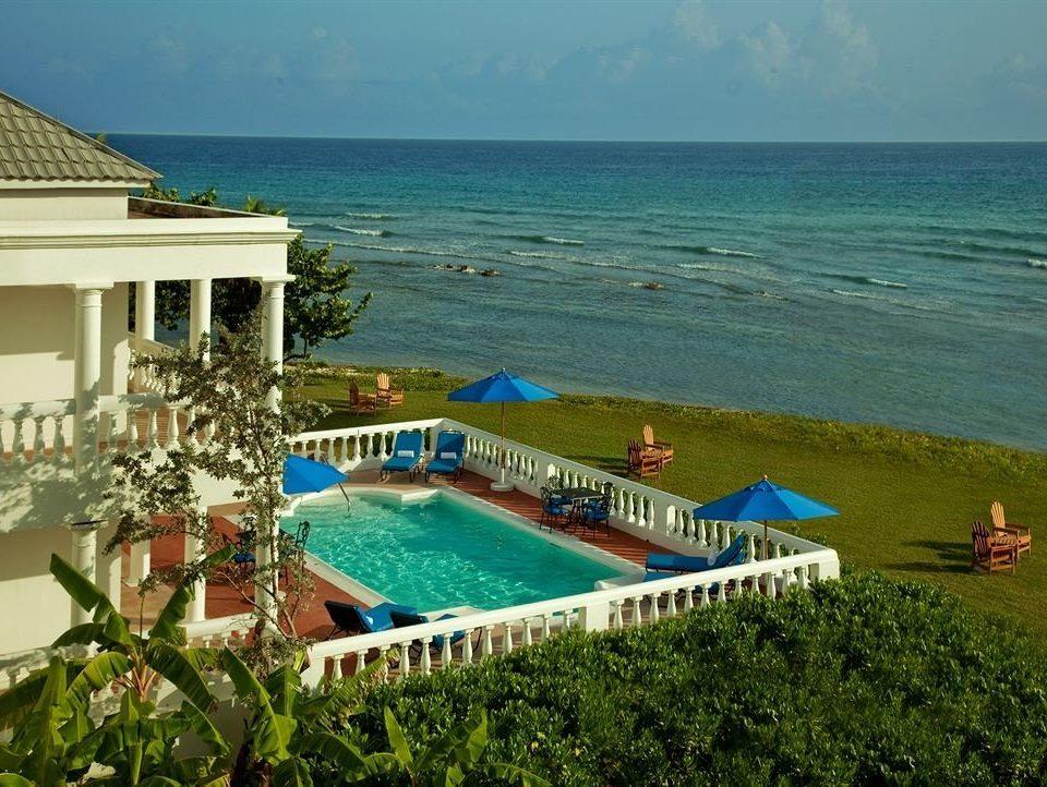 Beachfront Pool Scenic views Tropical Villa leisure property swimming pool Sea caribbean Resort Beach Ocean Coast Deck