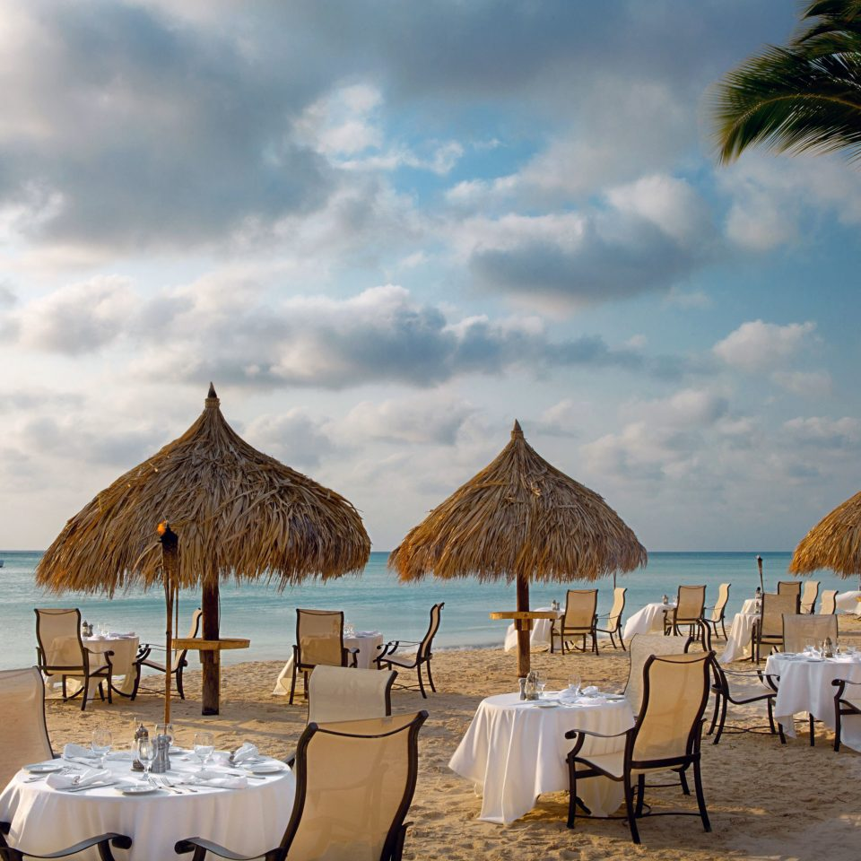 Beachfront Dining Drink Eat Hotels Resort Trip Ideas sky chair water umbrella Beach Sea Ocean lawn arecales Coast lined caribbean shore set shade day sandy
