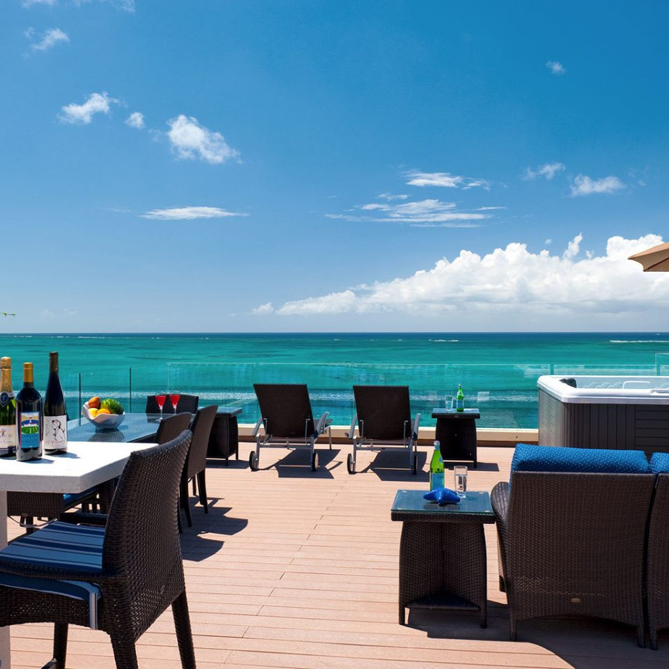 Beachfront Drink Eat Grounds Resort sky ground chair leisure Beach Ocean Sea caribbean swimming pool Coast passenger ship Villa shore day