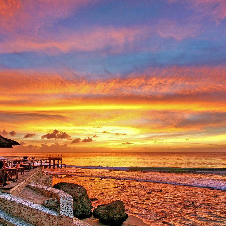 Beach Beachfront Elegant Luxury Modern Pool Scenic views sky Sunset shore sunrise afterglow horizon Sea Coast dawn Ocean cloud evening dusk morning setting