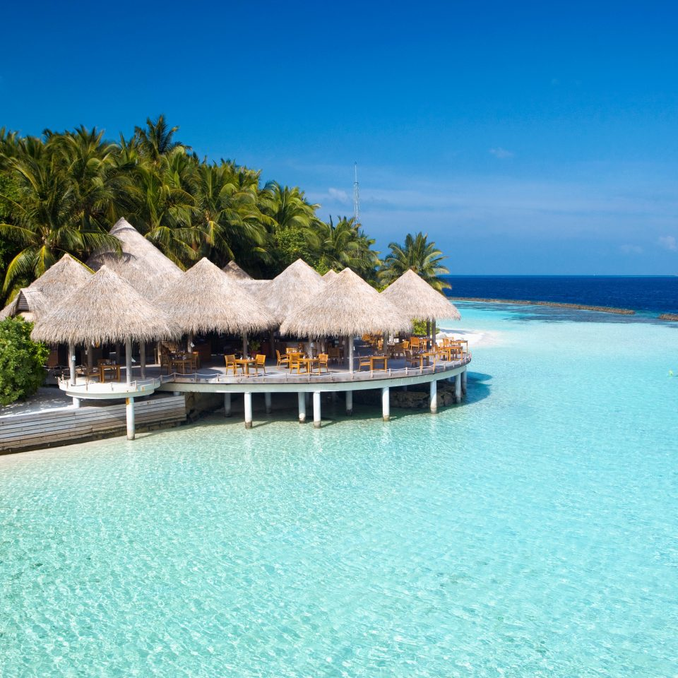 Beachfront Elegant Lounge Luxury Ocean Overwater Bungalow sky water tree caribbean Sea Resort swimming pool Beach Nature Coast Lagoon resort town Island tropics cape atoll islet reef shore day