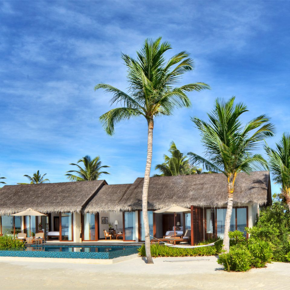 Beachfront Elegant Exterior Luxury Modern Romantic Villa tree sky house Beach Resort caribbean home arecales palm palm family Ocean Sea tropics Coast Village residential