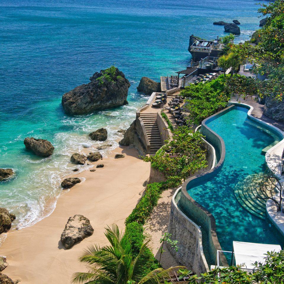 Beach Beachfront Elegant Luxury Modern Pool Scenic views water Nature Sea Coast Ocean caribbean tropics Resort cove cape terrain Island lined shore sandy