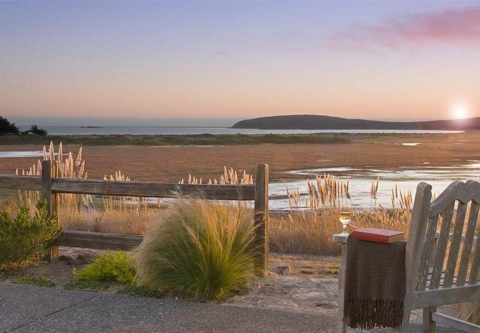 Beach Beachfront Exterior Ocean sky shore property Sea Coast walkway morning landscape Lake overlooking