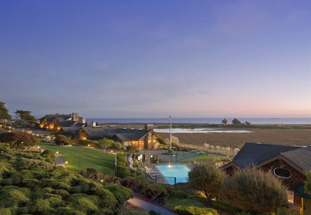 Beach Beachfront Exterior Ocean sky grass shore Coast Sea horizon morning dusk evening tower cape cove Resort lush