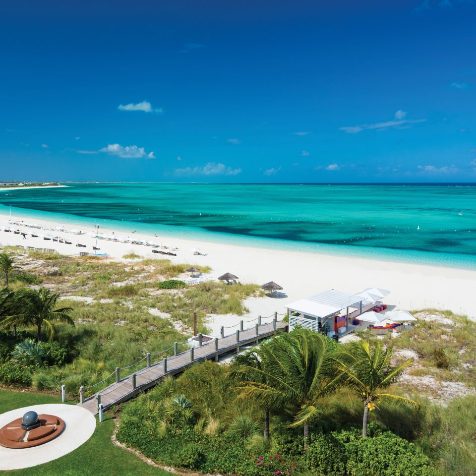 Beach Beachfront Exterior Grounds Hotels Ocean Outdoors Play Scenic views Trip Ideas sky grass water Nature shore Coast Sea horizon caribbean cape cove Lagoon islet swimming pool