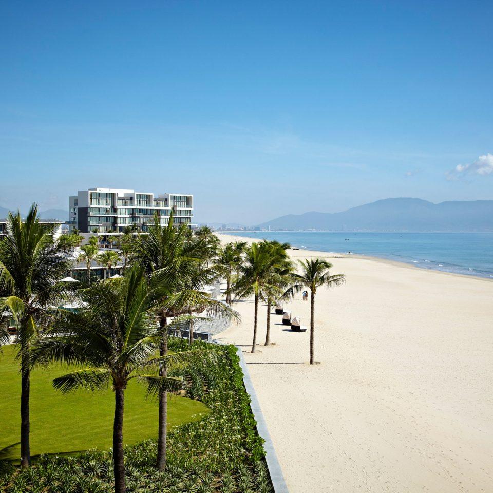 Beach Beachfront Exterior Family Modern Resort sky grass Sea horizon Nature Coast Ocean shore day