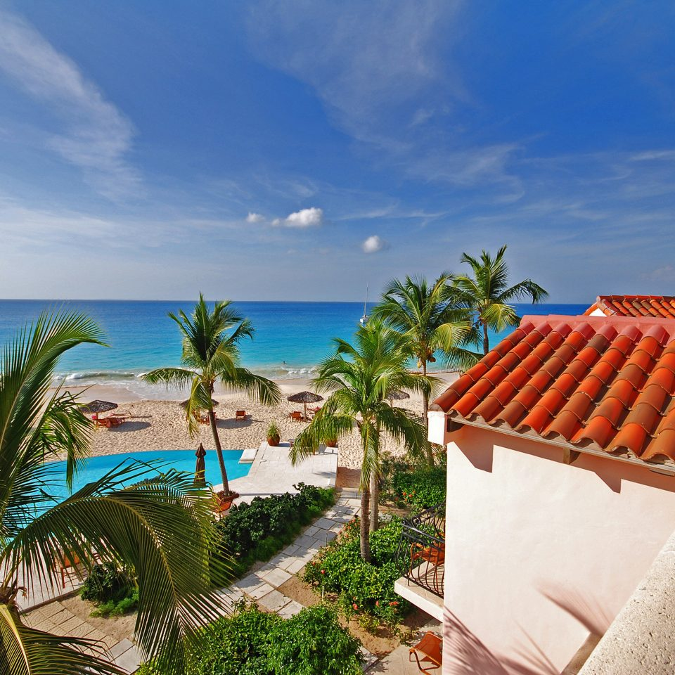 Beach Beachfront Exterior Lounge Ocean sky palm Sea caribbean arecales Coast Resort plant