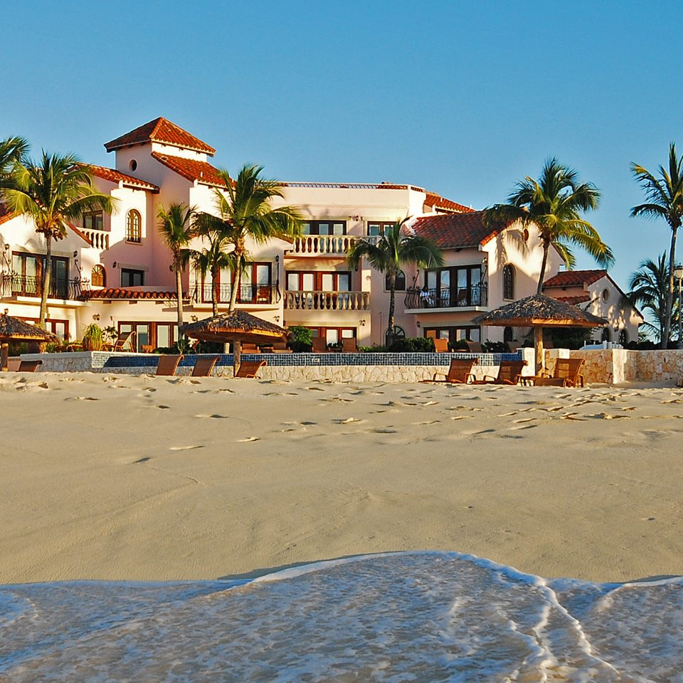 Beach Beachfront Exterior Lounge Ocean sky ground Sea Town Resort Coast sand Village shore sign sandy