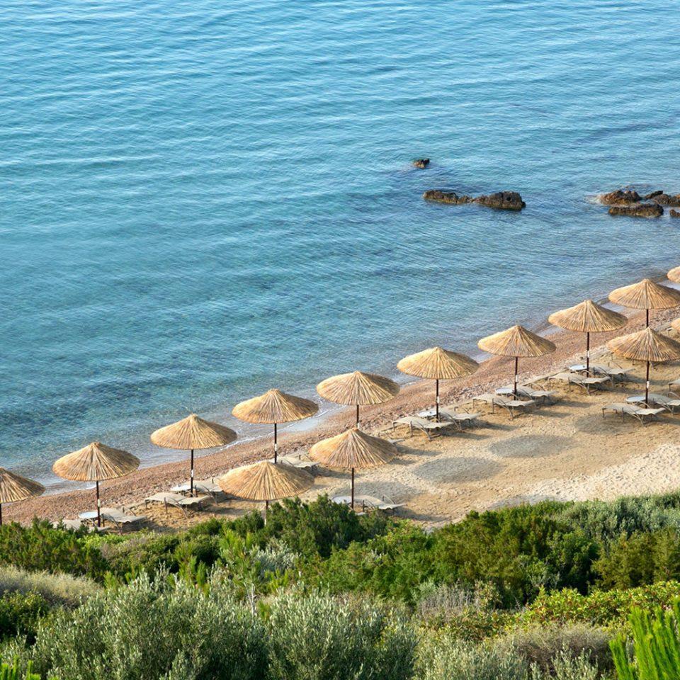 Beach Beachfront Family Resort Scenic views water grass Sea shore Coast Nature Ocean cape terrain cliff cove