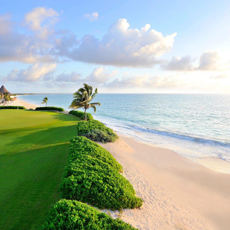 Beach Beachfront Family Grounds Play Resort Scenic views sky water grass shore Nature Coast Sea horizon Ocean sand cape terrain