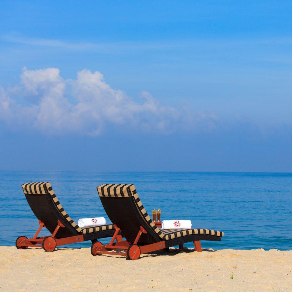 Beach Beachfront Family Island Resort Tropical sky water Sea transport shore Ocean horizon Coast aircraft vehicle sand sandy day
