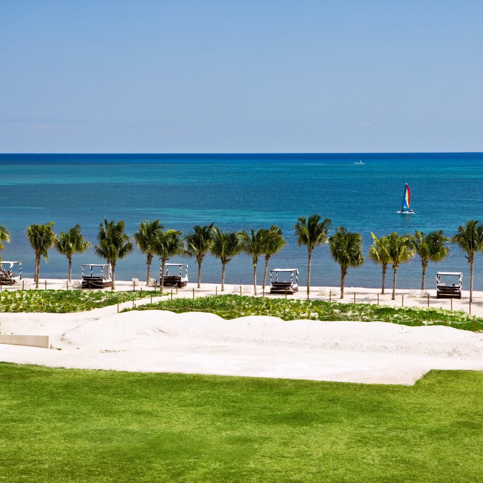 Beachfront Golf Ocean Sport Wellness grass sky water Nature Beach shore Sea lawn Coast Resort caribbean cape