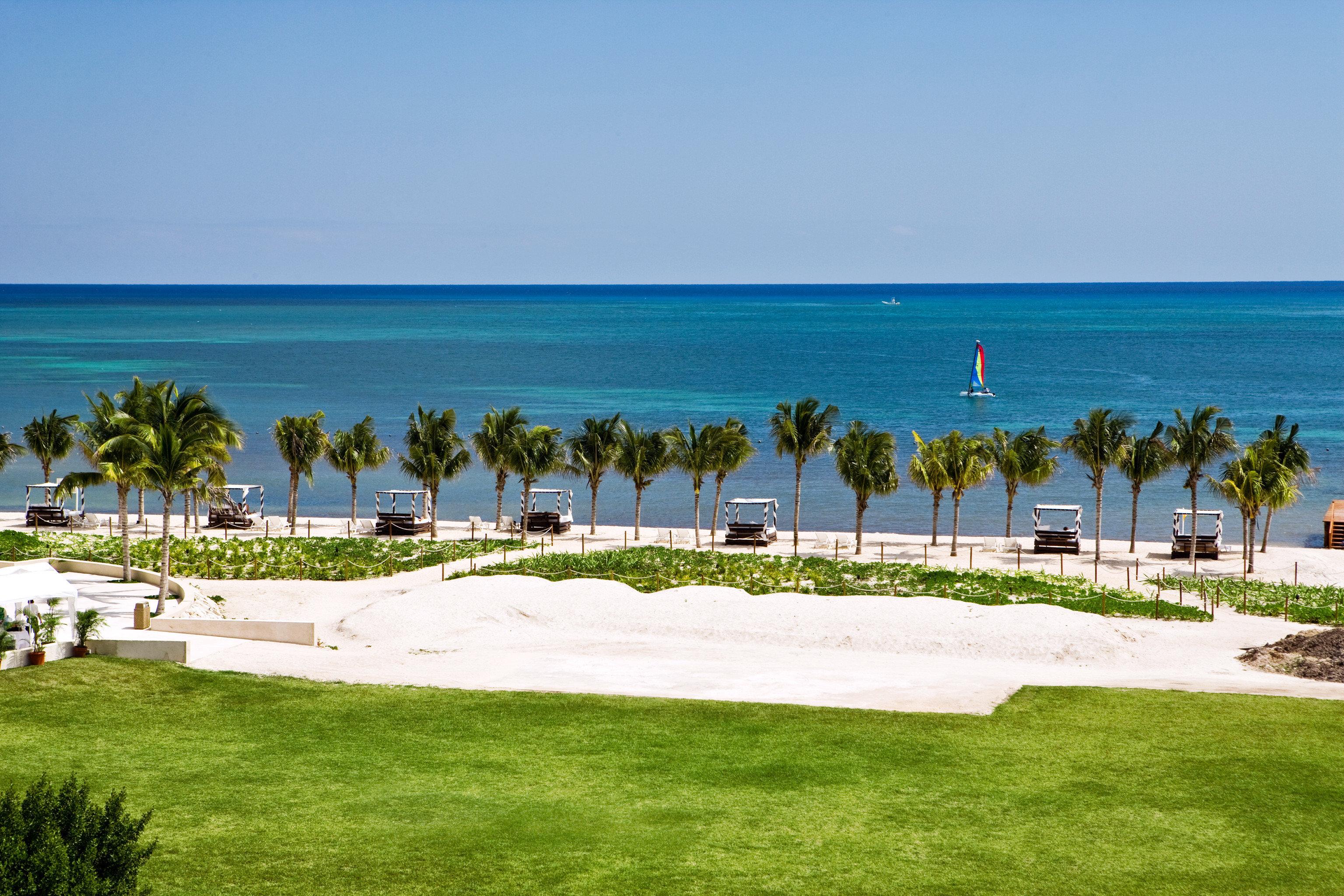 Beachfront Golf Ocean Sport Wellness grass sky water Nature Beach shore Sea lawn Coast Resort caribbean cape