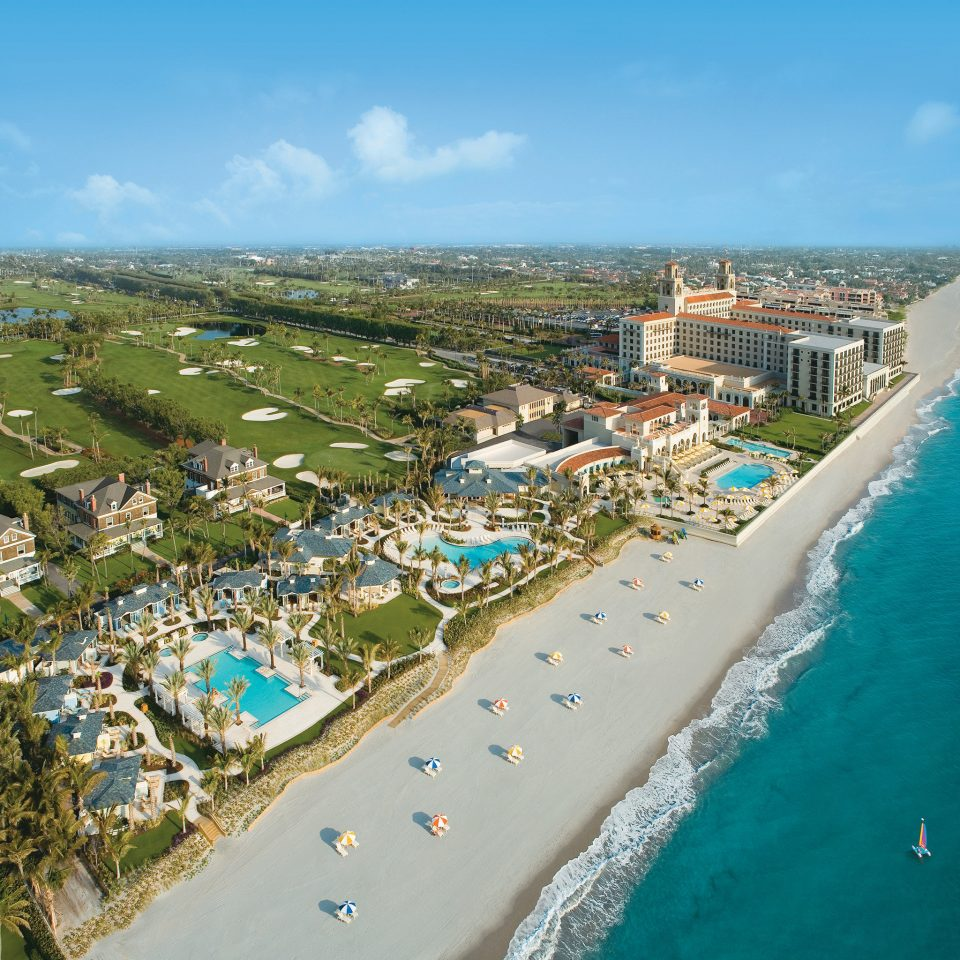 Beachfront Grounds Pool Trip Ideas Tropical sky aerial photography Town Coast Nature Sea Beach bird's eye view marina residential area cape Resort walkway waterway shore