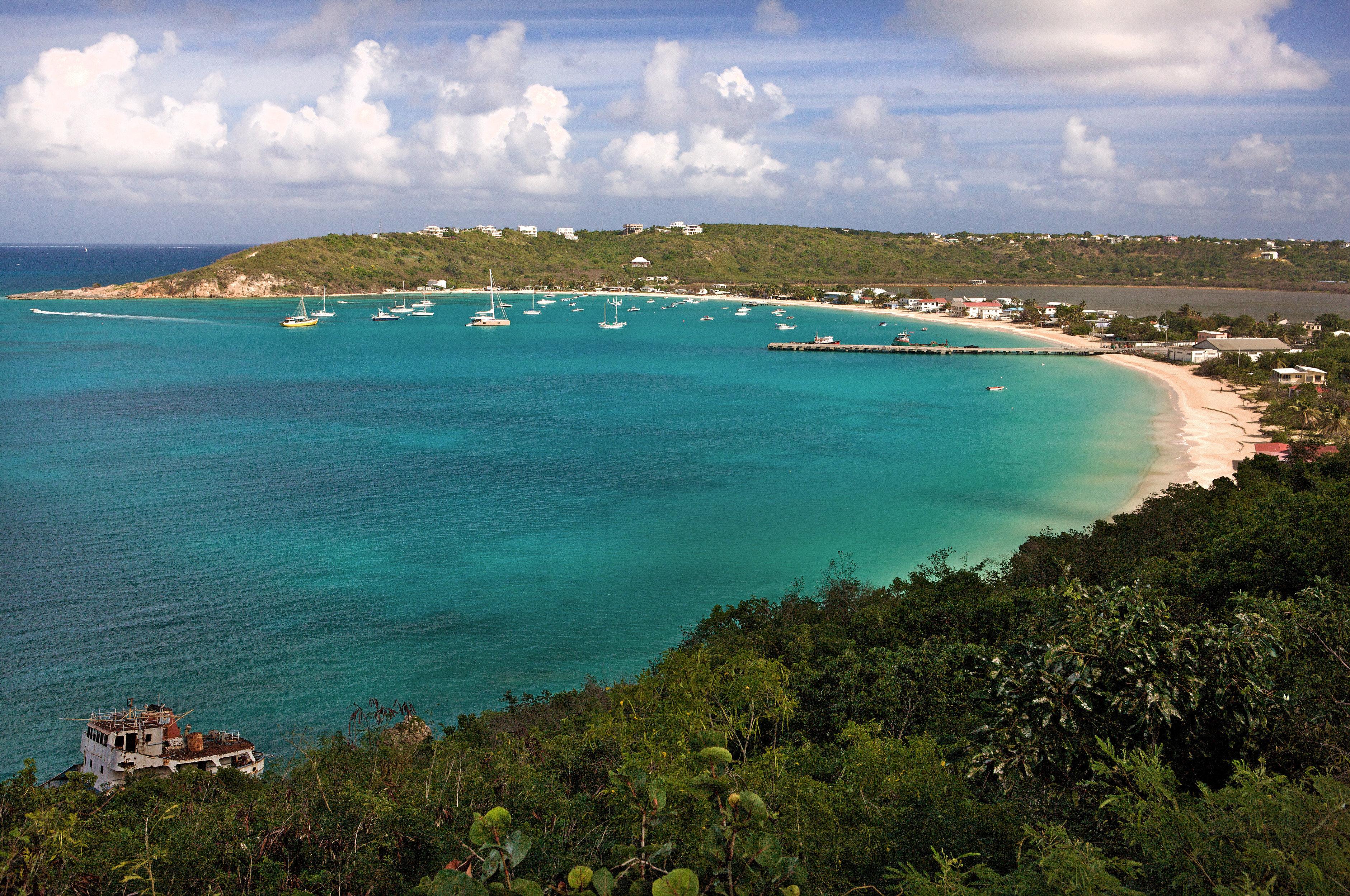 Beach Beachfront Grounds Ocean water sky Nature Sea Coast shore horizon reef islet cape cove Lagoon caribbean terrain archipelago Island cliff tropics promontory overlooking clouds day