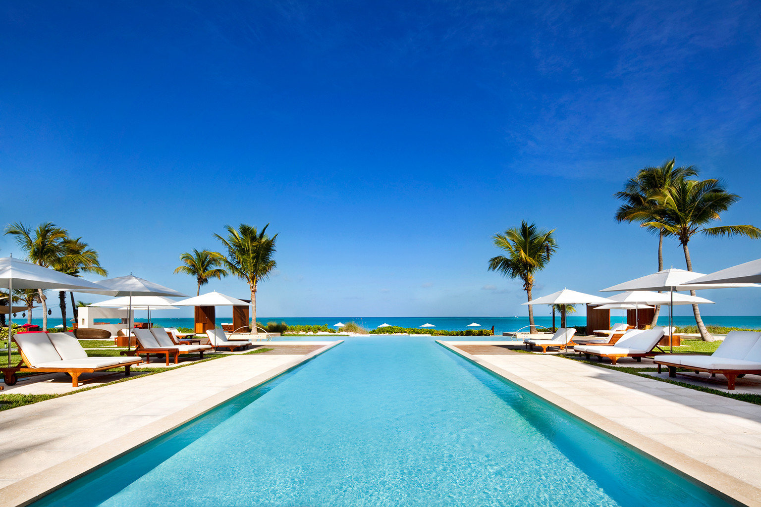 Beachfront Grounds Hotels Luxury Pool sky leisure swimming pool Beach Resort Sea caribbean Ocean way marina Coast Lagoon dock colorful lined highway