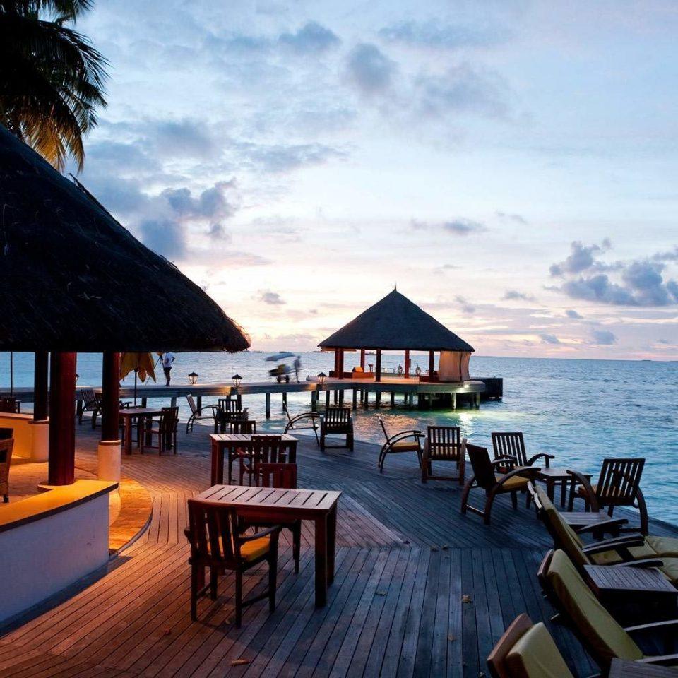 Beachfront Hip Hotels Lounge Luxury Modern water sky chair scene Sea Ocean wooden vehicle evening caribbean Resort Coast Beach Sunset set