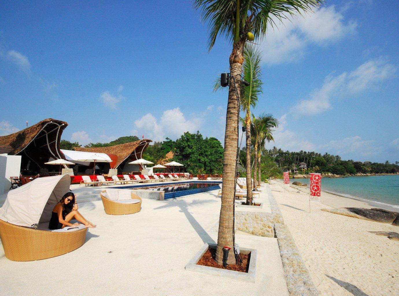Beach Beachfront Hip Island Ocean Outdoor Activities Tropical sky leisure Sea Resort arecales caribbean Coast walkway boardwalk travel swimming pool tree shore plant