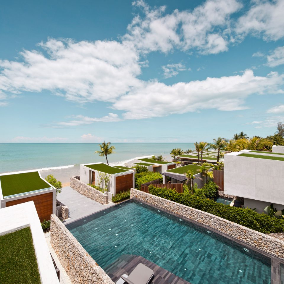 Beachfront Hip Modern Pool Romantic Scenic views sky property swimming pool Sea Ocean house Resort Coast green Villa home caribbean Beach dock cement