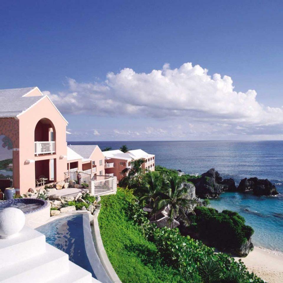 Beach Beachfront Hip Hotels Lounge Luxury Ocean sky Coast property Nature Sea caribbean Resort cape Villa Island cove