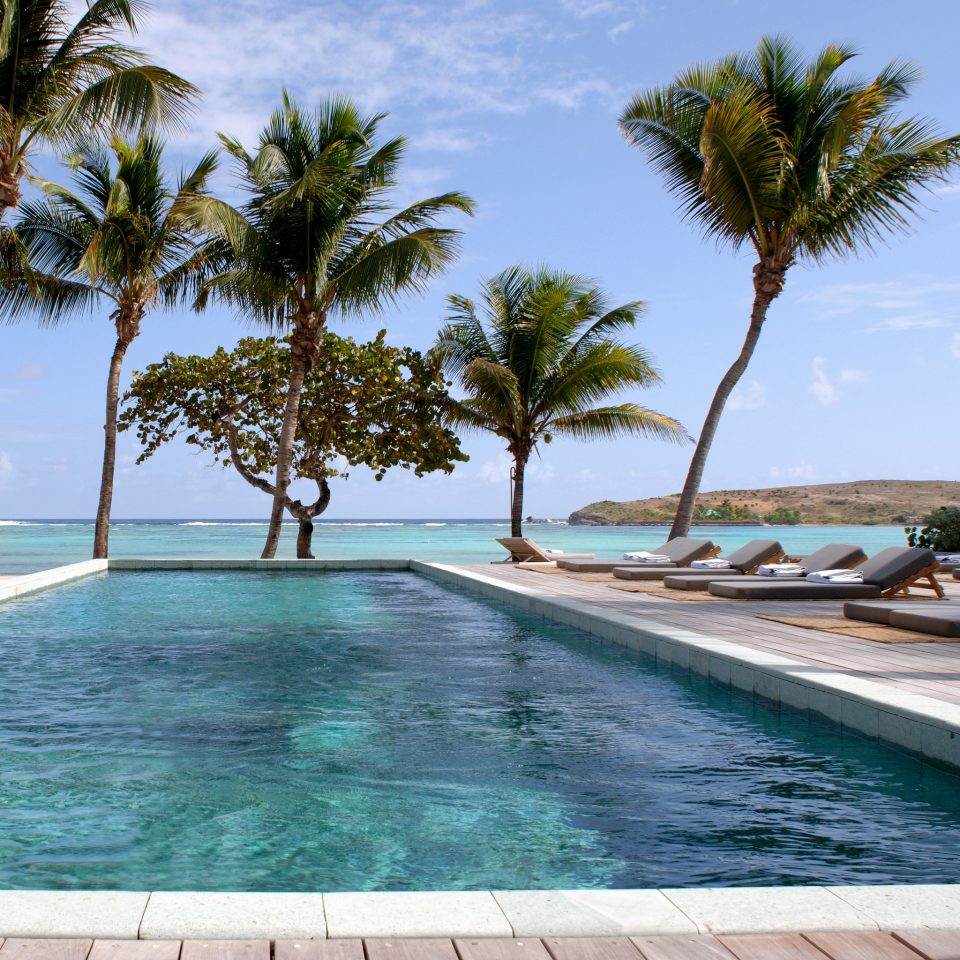 Beach Beachfront Honeymoon Luxury Pool Romance Romantic sky tree water palm swimming pool property caribbean Sea Resort Ocean arecales Lagoon Coast tropics palm family Villa atoll swimming lined sandy shore