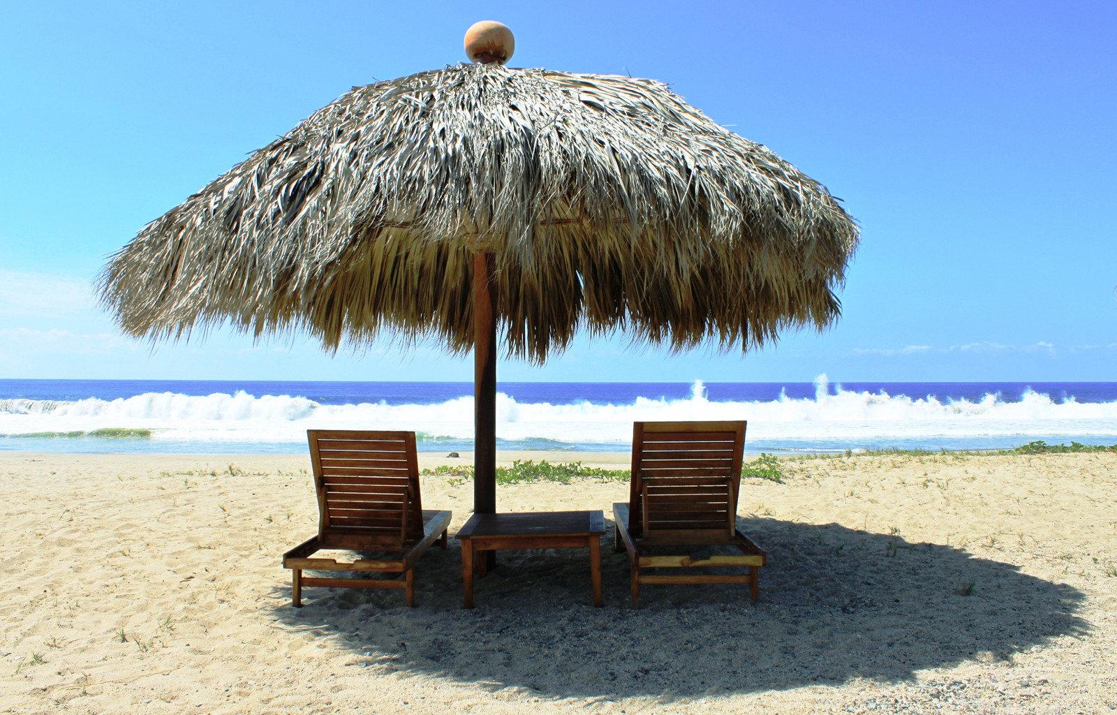 Beach Beachfront Honeymoon Romance Romantic Scenic views sky umbrella chair Sea tree shore Ocean sand arecales hut Coast lawn Resort sandy