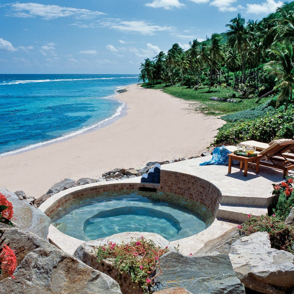 Beach Beachfront Hot tub/Jacuzzi Island Resort Romantic Scenic views Spa Waterfront Wellness sky water Nature Sea swimming pool Coast shore Ocean reef caribbean tropics
