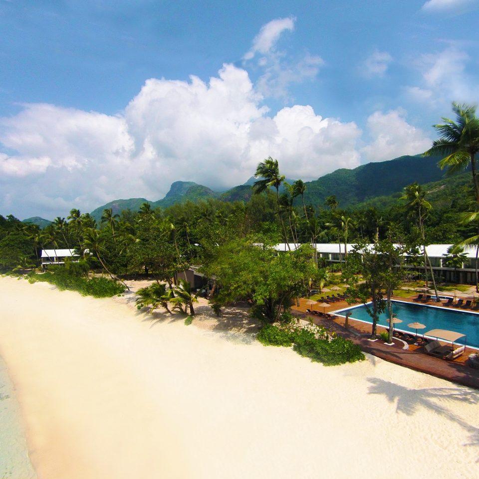 Beach Beachfront Hotels Luxury Pool Tropical sky Nature Sea Coast mountain caribbean Resort tropics Lagoon Island shore