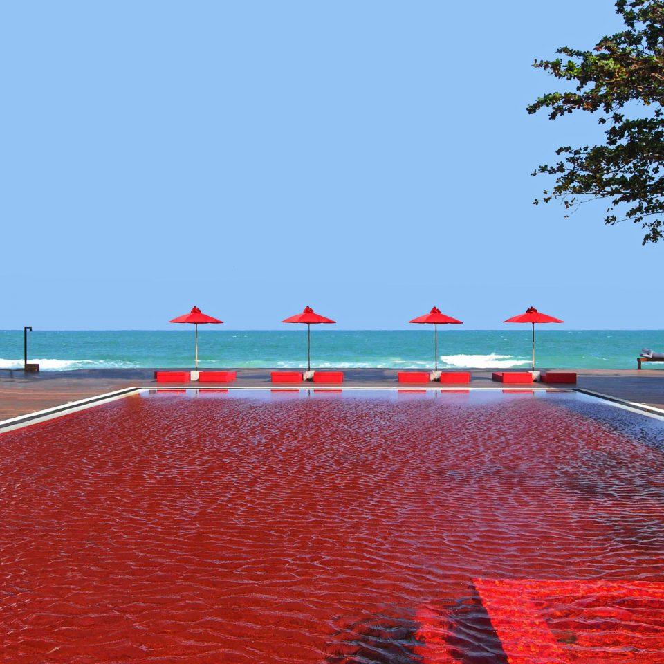 Beachfront Hotels Modern Patio Pool Tropical Waterfront sky water shore Sea horizon Ocean walkway Coast Beach orange