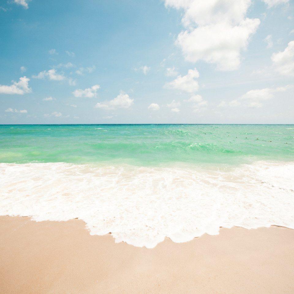 Beach Beachfront Hotels Ocean Outdoors Play Resort Romance Scenic views Trip Ideas sky water Sea Nature shore wave horizon sand wind wave cloud sunlight Coast sandy day