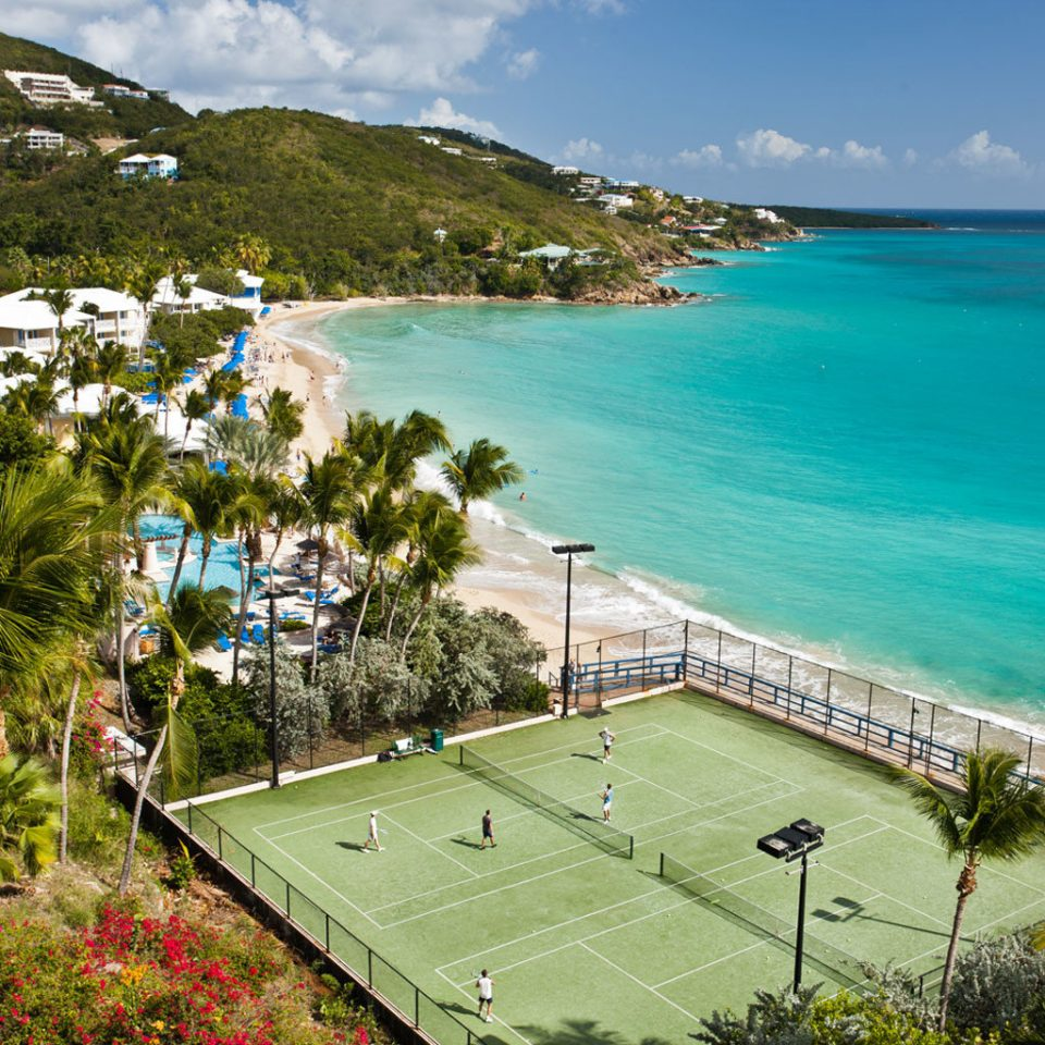 Beach Beachfront Hotels Outdoor Activities Play Resort Scenic views Sport Trip Ideas water sky mountain Coast Sea Nature sport venue swimming pool caribbean cape overlooking hillside
