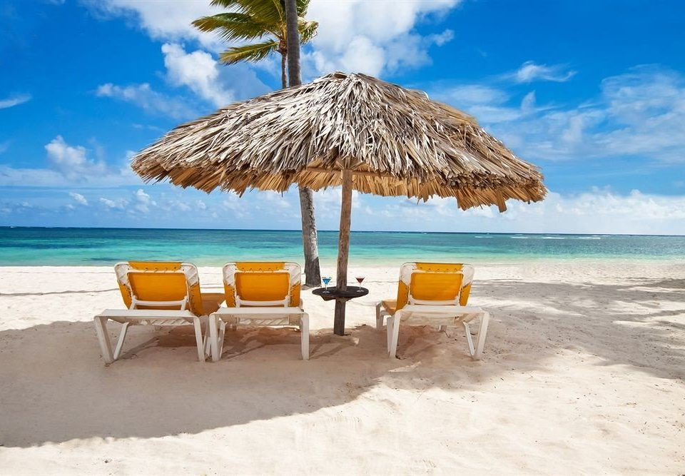 Beach Beachfront Lounge Luxury Ocean Romantic sky umbrella water chair shore Sea caribbean Nature Coast lawn sand Resort Island cape arecales Lagoon sandy day