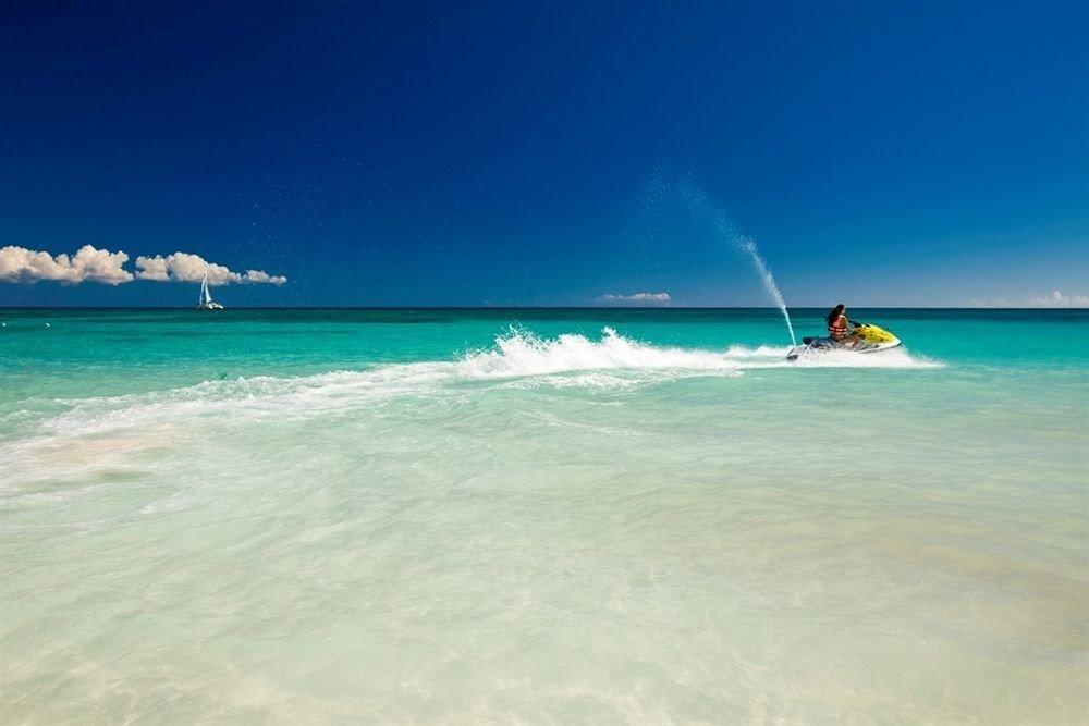 Beach Beachfront Luxury Ocean Tropical water sky Sea wind wave wave shore horizon caribbean Nature cape Coast Lagoon vehicle surfing islet surfing equipment and supplies Island day