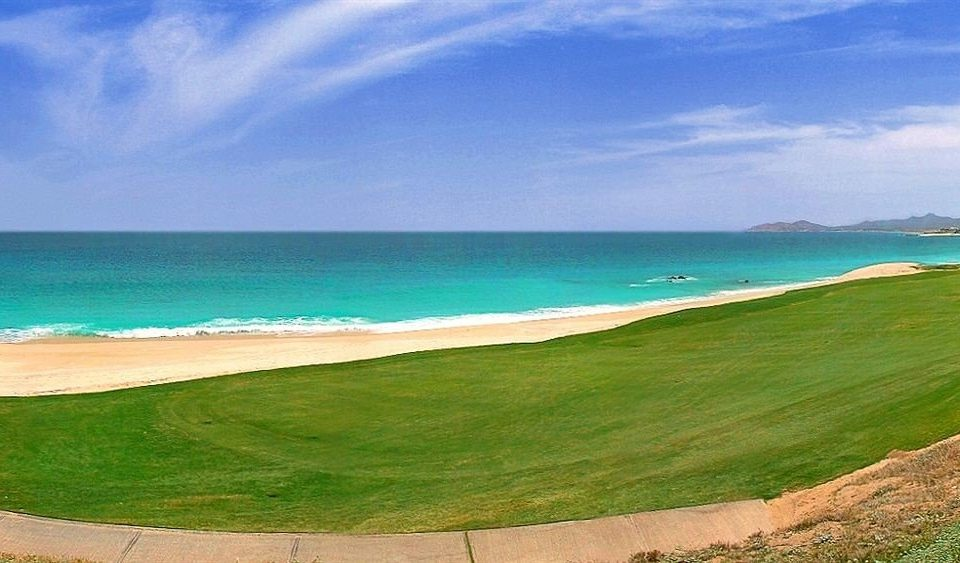 Beach Beachfront Ocean water sky grass Nature shore structure Sea Coast horizon sport venue cape caribbean wave golf course wind wave sports terrain overlooking Island