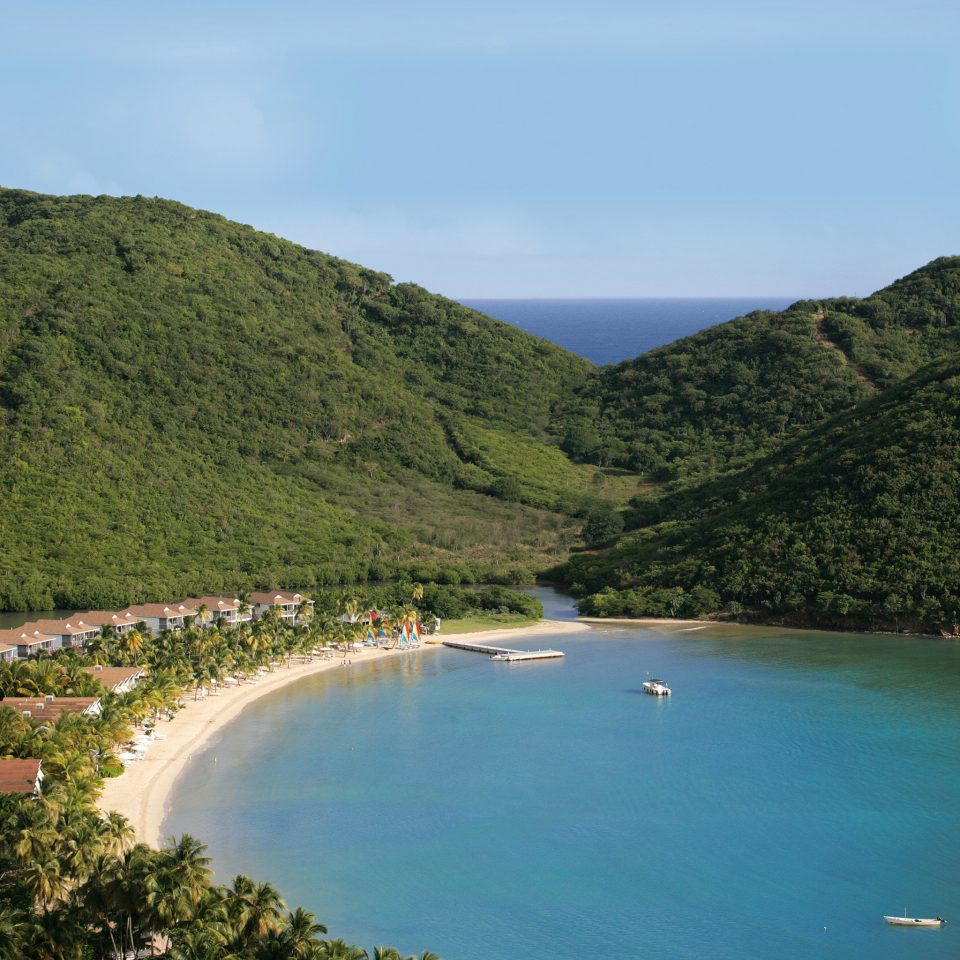 Beach Beachfront Island Luxury Resort Scenic views Tropical water sky Nature mountain Coast Lake Sea reservoir terrain surrounded shore