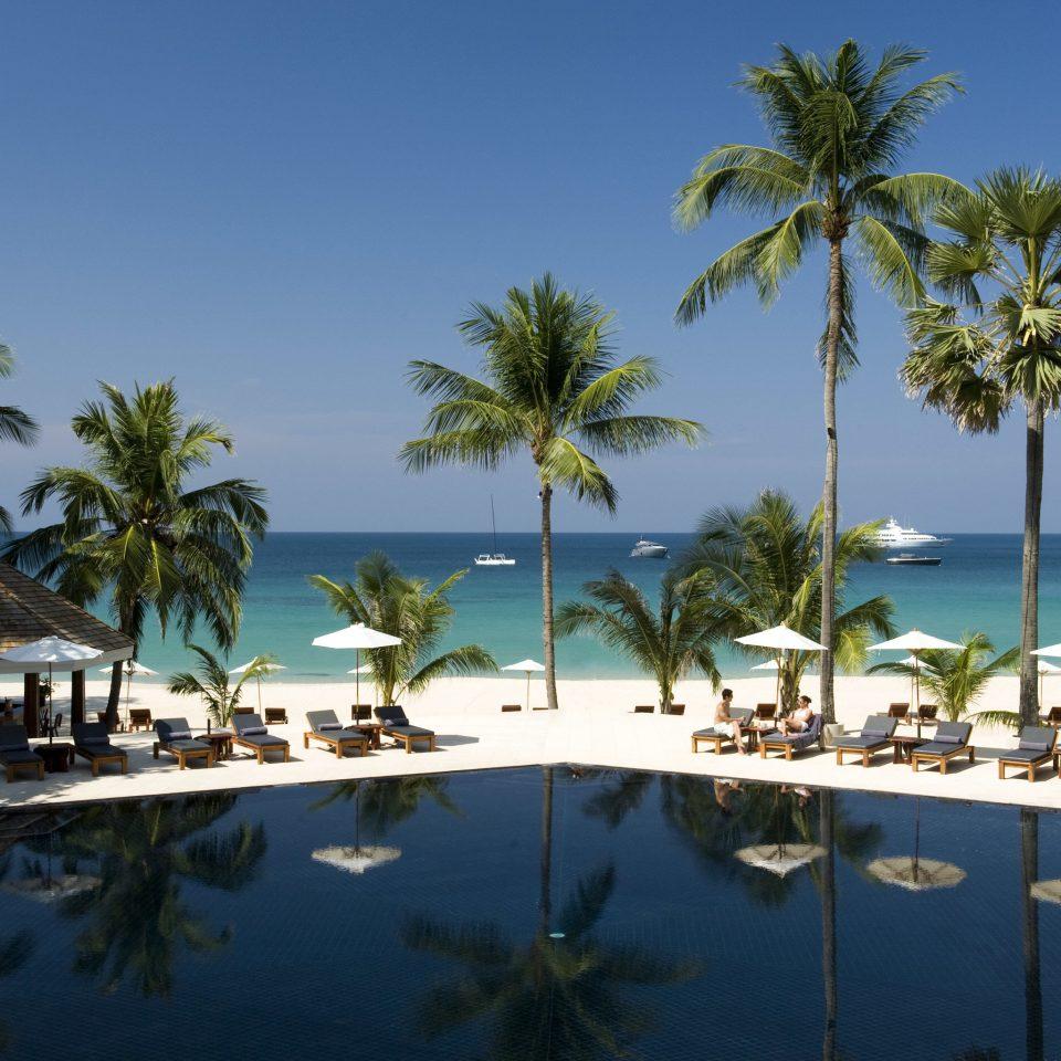 Beach Beachfront Outdoors Resort Scenic views tree sky water palm caribbean Ocean Sea arecales Coast Lagoon tropics swimming pool Island plant marina shore lined shade