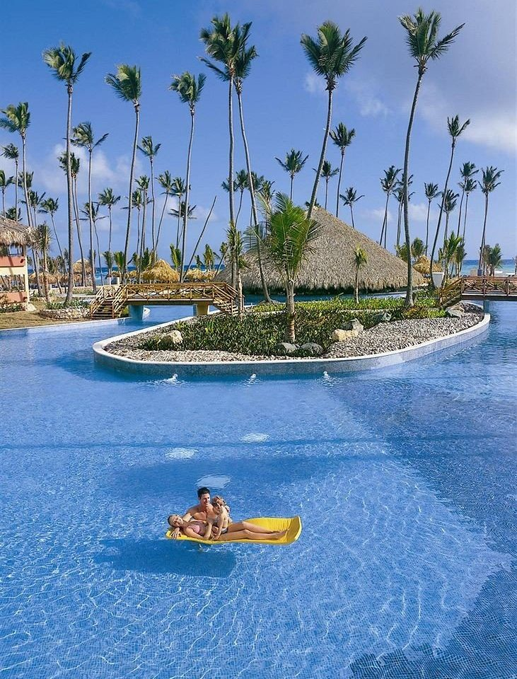 Beachfront Luxury Pool Tropical sky water tree Sea shore Ocean Beach caribbean Lagoon Resort Coast vehicle arecales Island swimming pool blue archipelago cove cay boating islet swimming