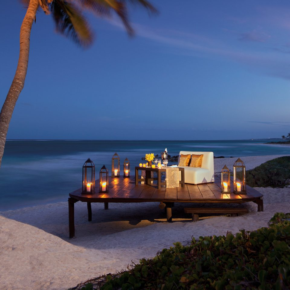 Beach Beachfront Lounge Luxury Ocean Romantic sky water Sea shore Coast horizon Sunset evening dusk Island cape vehicle caribbean tree plant