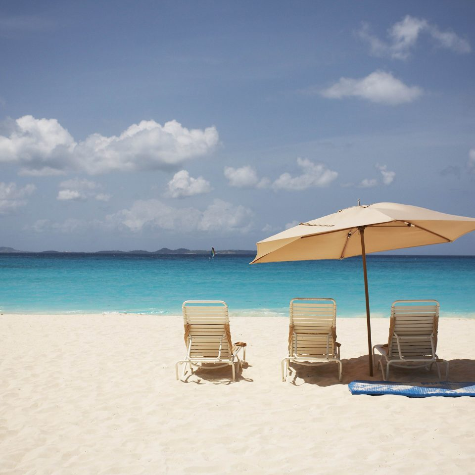 Beach Beachfront Lounge Ocean sky water umbrella chair Sea shore horizon Nature Coast sand Island caribbean cape wind Lagoon day sandy