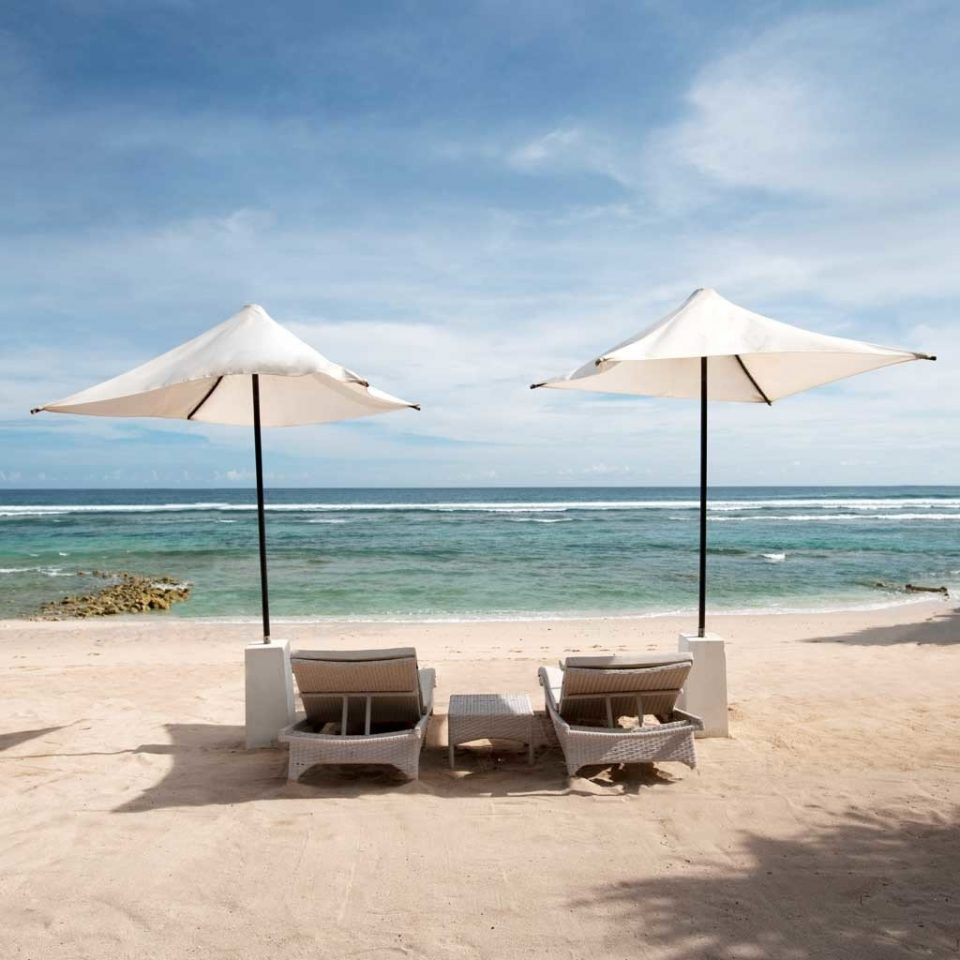 Beach Beachfront Luxury Ocean sky umbrella water ground Nature chair shore Sea Coast caribbean lawn Island wind cape sandy day sand empty shade highland