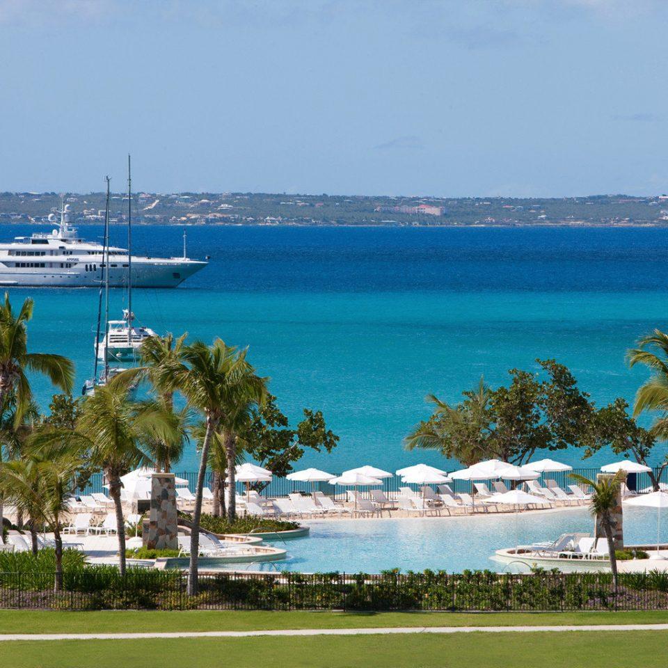 Beach Beachfront Lounge Luxury Ocean sky water Sea shore caribbean Coast Resort vehicle arecales marina cape Lagoon cove Island dock land