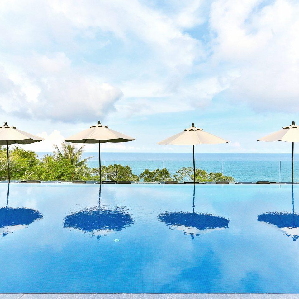 Beach Beachfront Luxury Nature Ocean Outdoors Pool sky water shore ecosystem Sea Lagoon swimming pool Resort caribbean archipelago Coast Lake Island clouds day