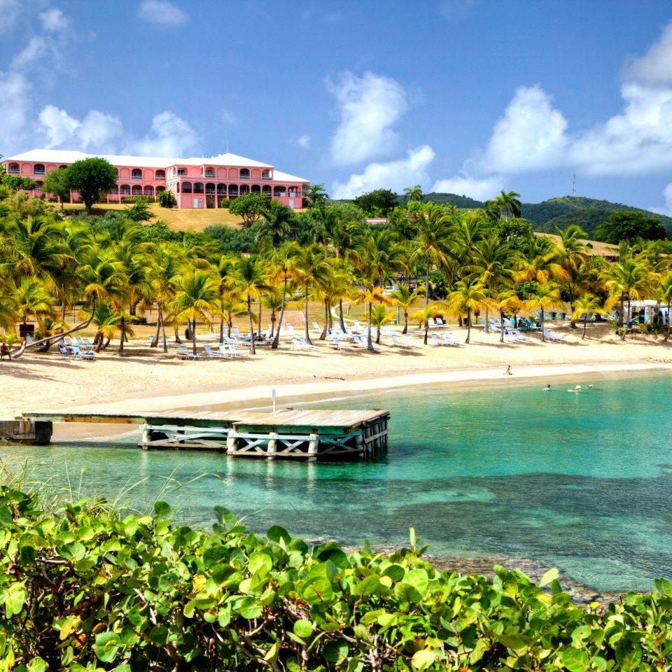 Beach Beachfront Island Scenic views water sky Sea shore Coast caribbean Nature tropics Ocean Resort Lagoon cove day