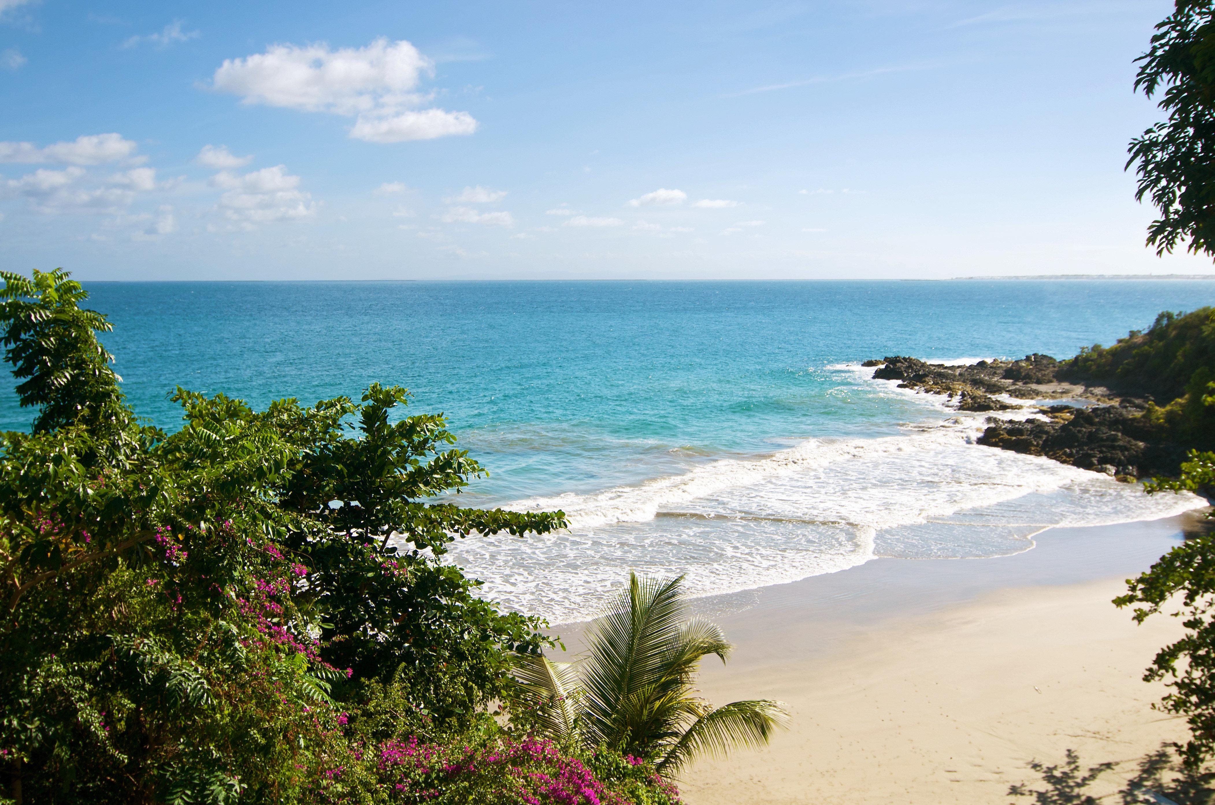 Beach Beachfront Luxury Ocean water sky tree Nature shore Sea Coast caribbean tropics overlooking cape cove terrain plant sandy Island day