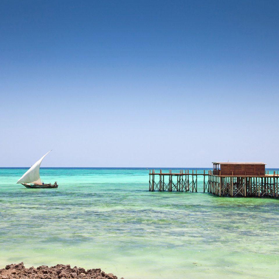 Beach Beachfront Resort Scenic views sky water shore Sea horizon Ocean Coast caribbean Lagoon Island cape pier distance