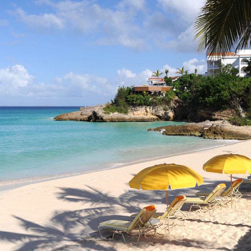 Beach Beachfront Island Nature Outdoor Activities Scenic views Waterfront sky water umbrella chair Sea shore lawn Ocean Coast caribbean tropics lined arecales sand cape sandy swimming line